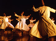 See dervishes whirl